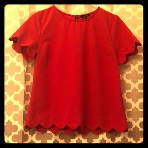 Red scalloped blouse